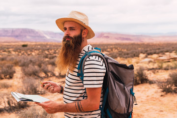 traveler navigating by compass and map