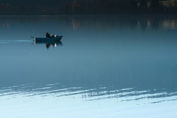 Angler in the evening at Schluchsee in Hochschwarzwald, Germany