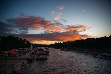 Sunset near the big river in sity. Bridge and a lot of boats