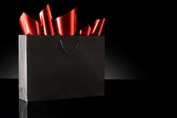 Shopping bag against a black background