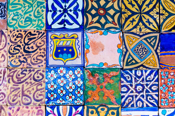 Beautiful handmade tiles of the blue media in Chefchaouen in Morocco