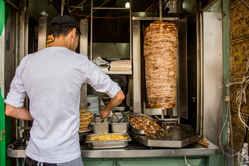 Person cooking a gyro