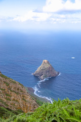 The Anaga Mountains Nature Park -  clouds and sun shine in the greenest part of Tenerife, Canary Islands, Rocks, plants, sea and the rain forest.