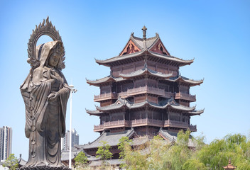 Statue and tower at Guiyuan Buddhist Temple in Wuhan Hubei China