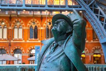 The Betjeman statue of sir John Betjeman at St. Pancras stationin London, UK