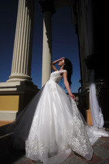 Elegant wedding salon is waiting for bride. Beautiful wedding dresses in boutique. Happy bride before wedding. Wonderful bridal gown. woman is preparing for wedding. Welcome to family. Happy moment