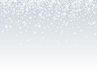 Falling white snowflakes on light background. Snow background.