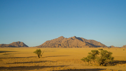 landscape with mountains and blue sky in Namibia desert