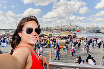 Beautiful woman poses with view of Galata Tower