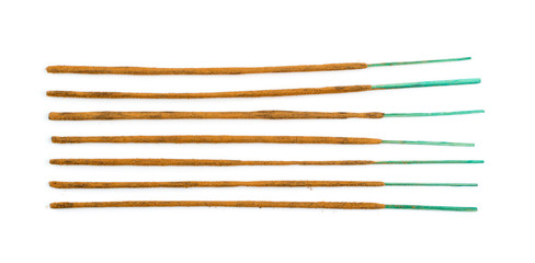 Brown indian incense aroma sticks isolated on white background