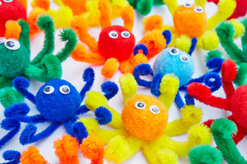 Little octopus colored toys isolated on white. Animal toys