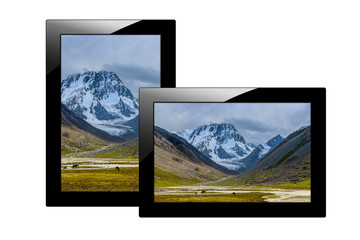 Modern black tablet computer isolated on white background. Tablet pc and screen with Image of mountains.