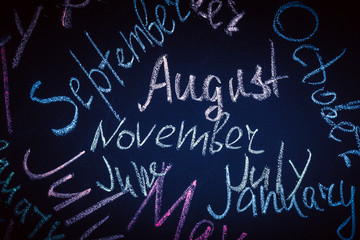 months written in colorful chalk, background image