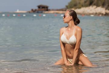 Sensual woman sitting in water