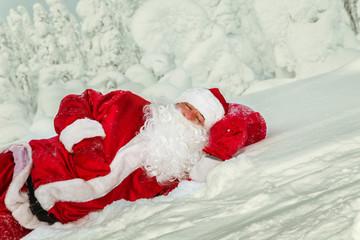 Tired Santa Claus fell asleep in the open air.