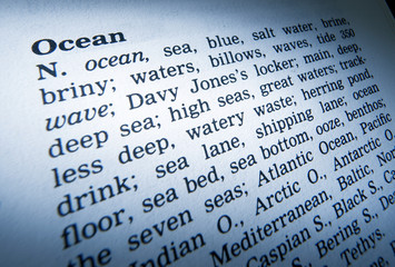 CLOSE UP OF DICTIONARY PAGE SHOWING DEFINITION OF THE WORD OCEAN