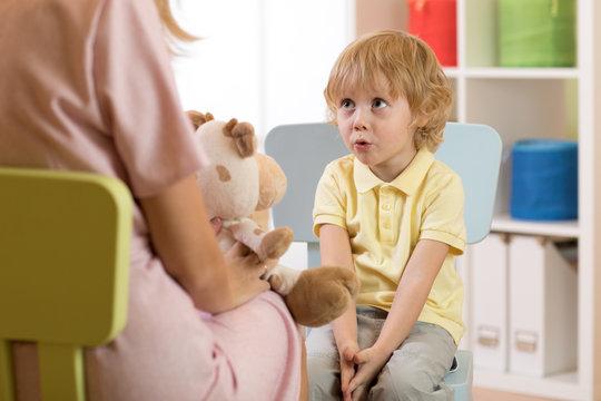 Cute little child boy at speech therapist office