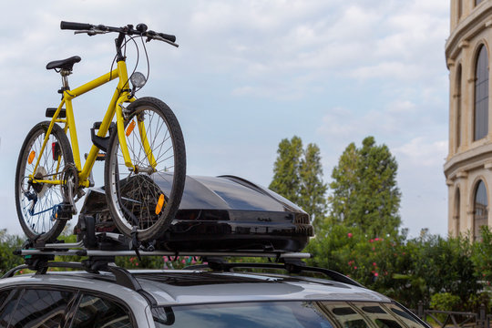 Transportation of bicycles on the roof of the car. Concept: a car trip with a bike