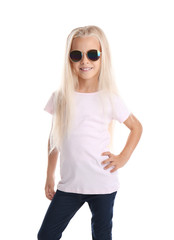 Cute little girl in t-shirt with sunglasses on white background