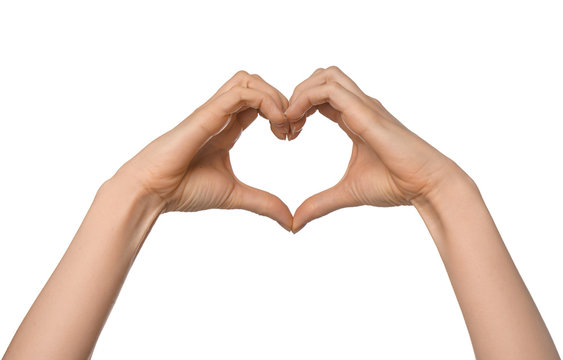 Woman making heart with her hands on white background