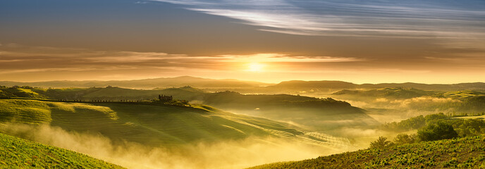 Wall Mural - Idyllic view, foggy Tuscan hills in light of the rising sun