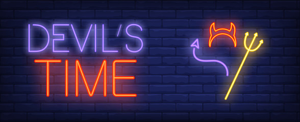Devil time neon text with horns, tail and trident. Halloween party invitation advertisement design. Night bright neon sign, colorful billboard, light banner. Vector illustration in neon style.