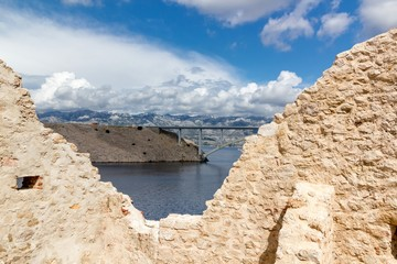 Walls of fortress and the Pag bridge, Island of Pag, Croatia