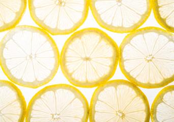 Plenty sliced lemon on white background