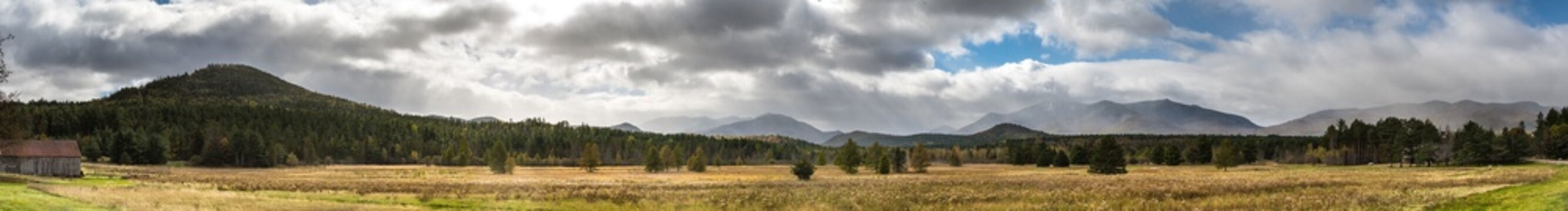 Panoramic view of a late fall mountains scene with spectacular sky near Lake Placid NY