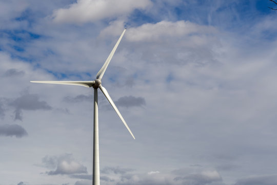 Wind turbine close up with cloudy sky in Quebec