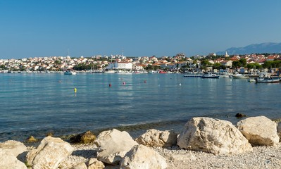 Stone shore in front of town of Novalja, landscape view, Croatia