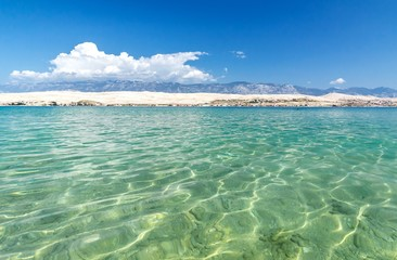 Blue turquoise water in front of island of Pag, Croatia