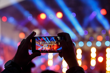 Video and photo recording of the concert by smartphone. Color music.