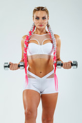 Sporty fit woman, athlete with dumbbells makes fitness exercising on white background.