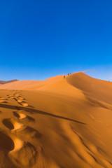 Footprints in beautiful sunlight, Big Daddy Dune, Sossusvlei, Namib-Naukluft National Park, Namibia