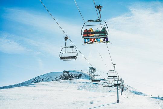 People on ski lift in winter ski resort