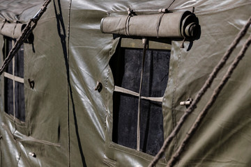 The window of an army military tent is shot close up.