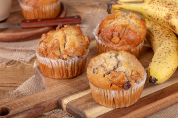 Banana Nut Muffins on a Wooden Board