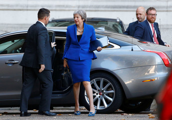 Britain's Prime Minister Theresa May arrives at the back entrance to Downing Street in London