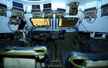 "Driver-mechanic's cabin of Ukrainian armored personnel carrier ""Varta"": seat, wheel, dashboard"
