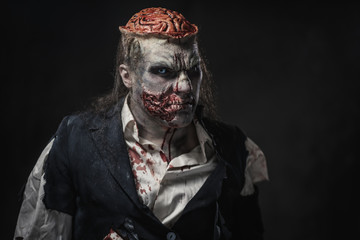 Scary zombie prostheric makeup on male model