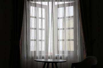 Window curtain with soft light and furniture design at home background