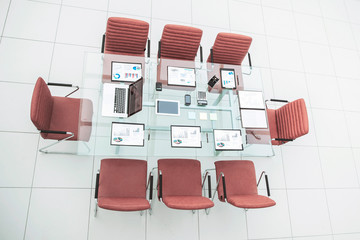 top view - a place for business meetings in the modern conference room. on the desktop,