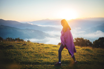 Young Pretty Girl Walk through the Morning Mountain Landscape