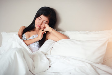 young and sexy woman fall asleep on bed room