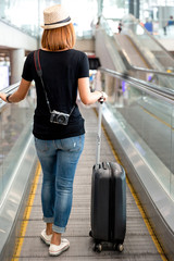Woman drag baggage