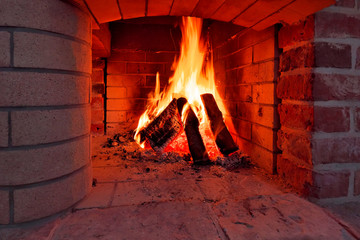 Flaming logs in fireplace.