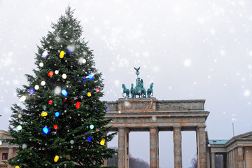 Printed roller blinds Berlin Bradenburg Gate with decorated Christmas tree at winter day with falling snow, Berlin, Germany