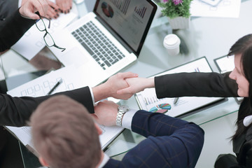 close up.handshake business partners over the Desk