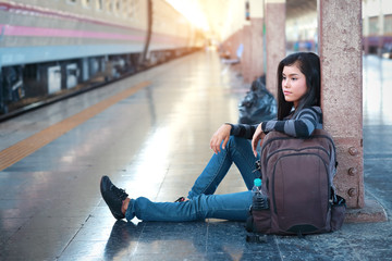 young traveler woman sitting and waiting for train